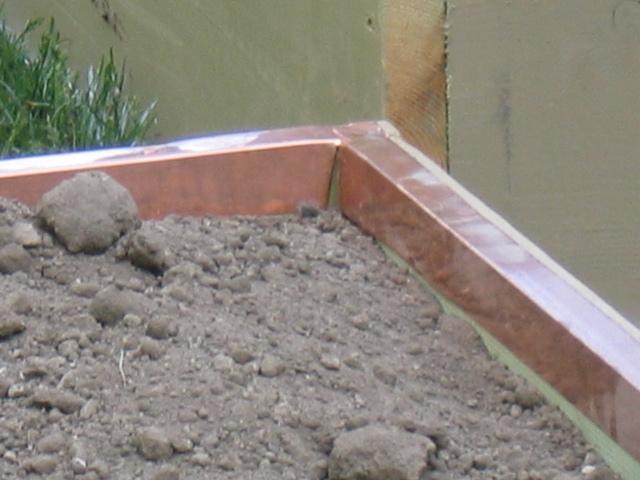 Planter Slug-Strip Detail